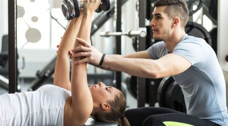 Fitness-instructor-exercising-with-his-client-at-the-gym_80960258-1600x1600